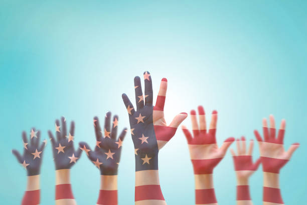 American flag pattern on people's hand group raising up group American flag pattern on people's hand group raising up group citizenship stock pictures, royalty-free photos & images