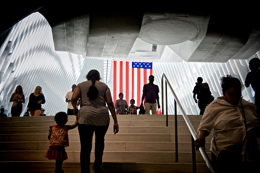 American Flag People Passing Through World Trade Transportation Hub Nyc Stock Photo - Download Image Now