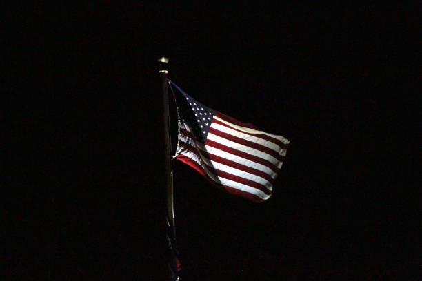 American Flag American Flag in the night light. flagpole stock pictures, royalty-free photos & images