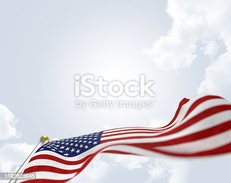 American flag on sky background blowing in the wind
