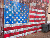 American flag painted on wall by street