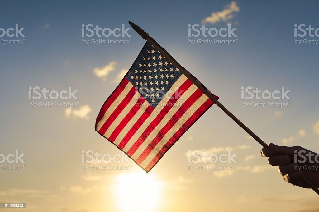 Hand waving american flag.