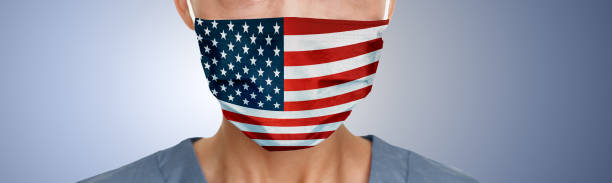 USA american flag print on face mask protective PPE doctor panoramic banner stock photo