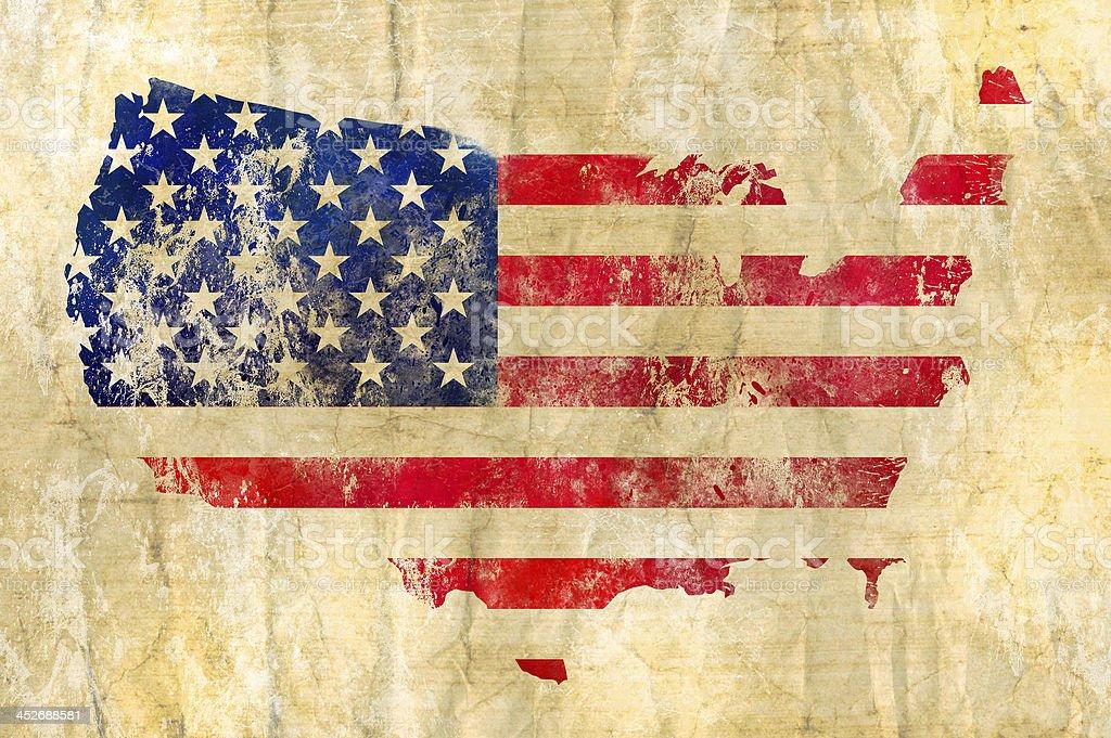 American flag shaped like America on brown cloth stock photo