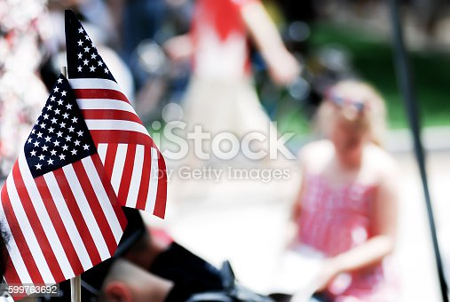96695299 istock photo American flag show on 4th of july parade 599763692
