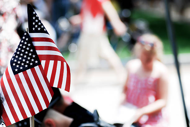 american flag show on 4th of july parade - geçit töreni stok fotoğraflar ve resimler
