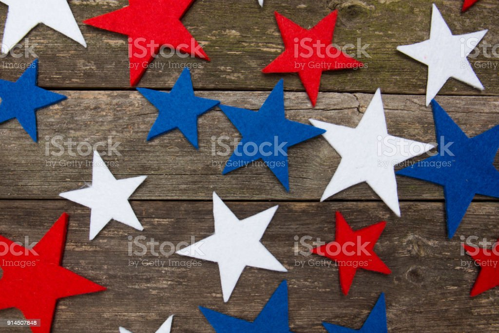 American flag stars on wooden table. Independence day. Patriotic holiday stock photo