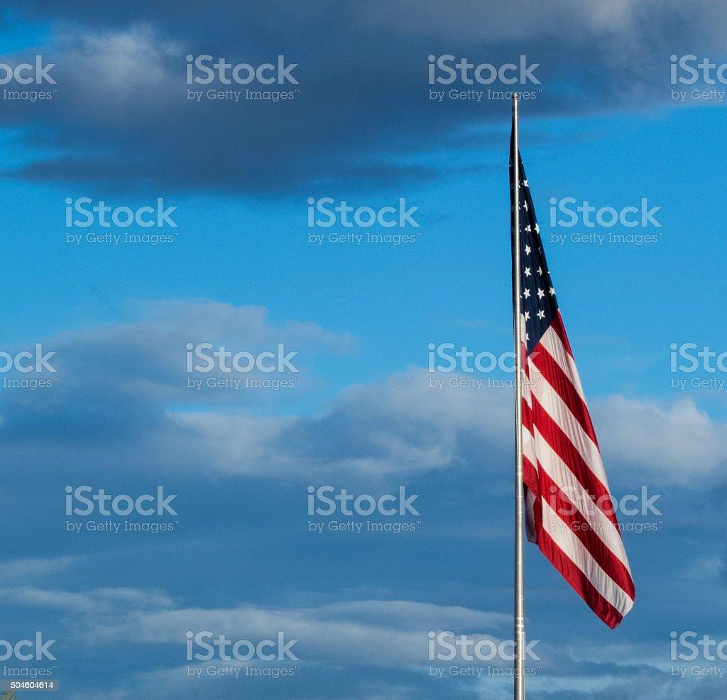 American Flag, Stormy Sky stock photo