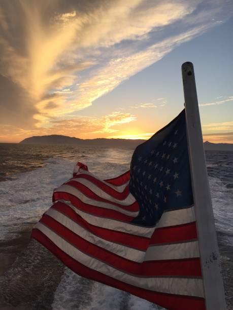 American flag sunset over Catalina Island stock photo