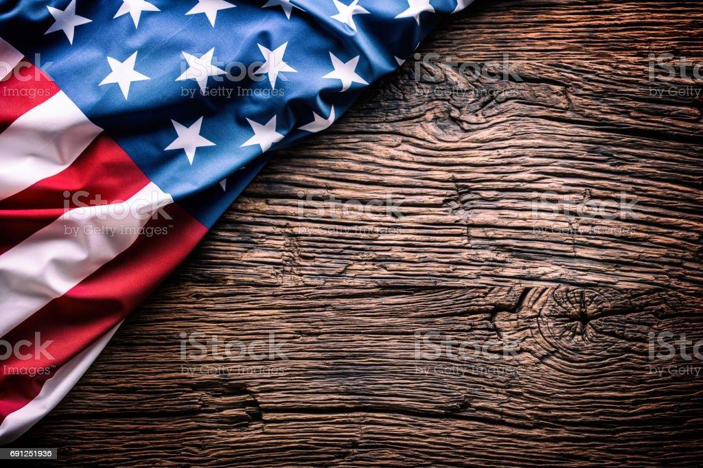 American  Flag. Usa flag on rustic oak board diagonally stock photo