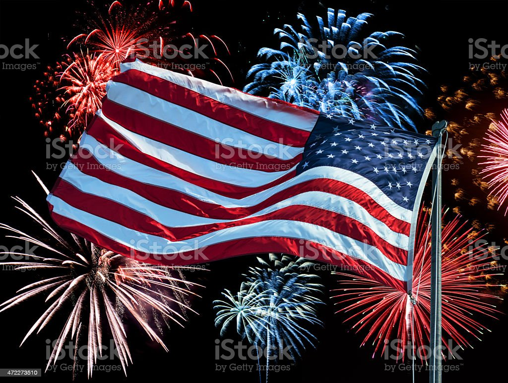 american flag waving for a national holiday stock photo