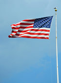 istock American flag waving in a sky 512524107