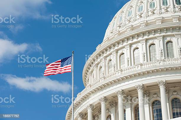 American flag waving in front of capitol hill picture id155377752?b=1&k=6&m=155377752&s=612x612&h=ucwlibjchyboid2vn3iutlvesbivzmh1aisugtovce8=