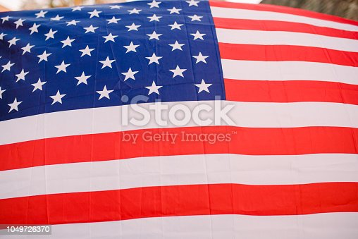 687972458 istock photo American flag waving 1049726370