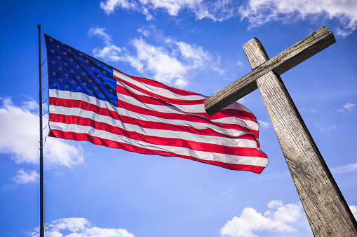 American flag with a wooden cross symbol of the blessed American nation.