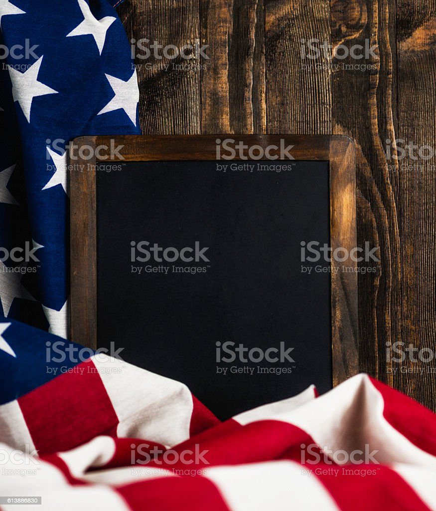 American flag with blank chalkboard for US holidays. Wood background stock photo