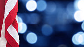 istock American Flag With Blue Bokeh Lights Background 971116546