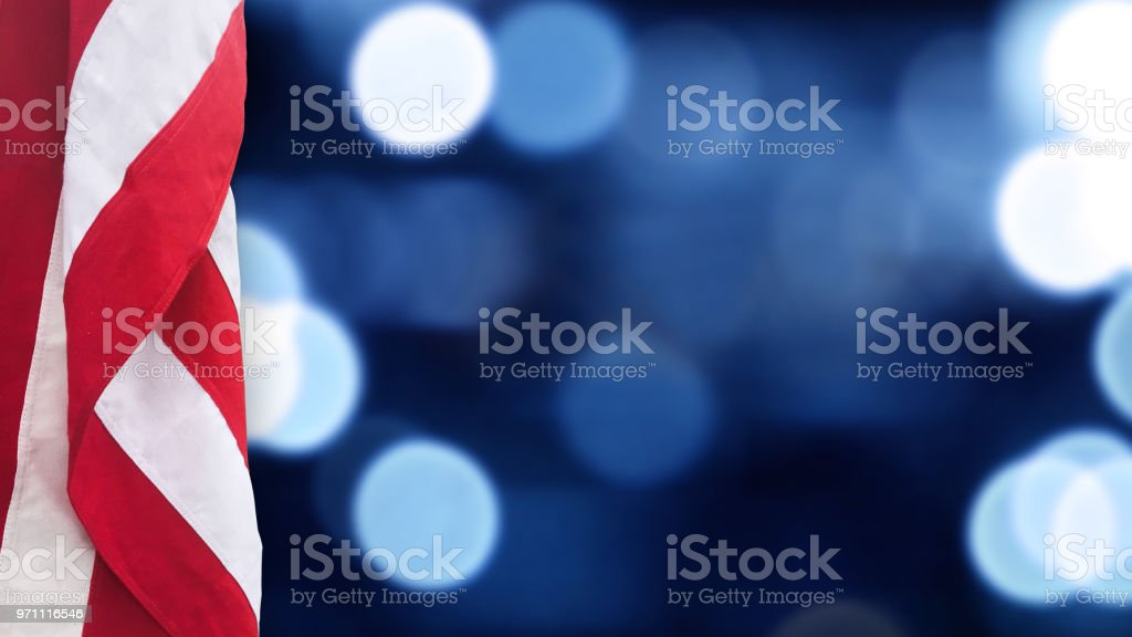 American Flag With Blue Bokeh Lights Background stock photo