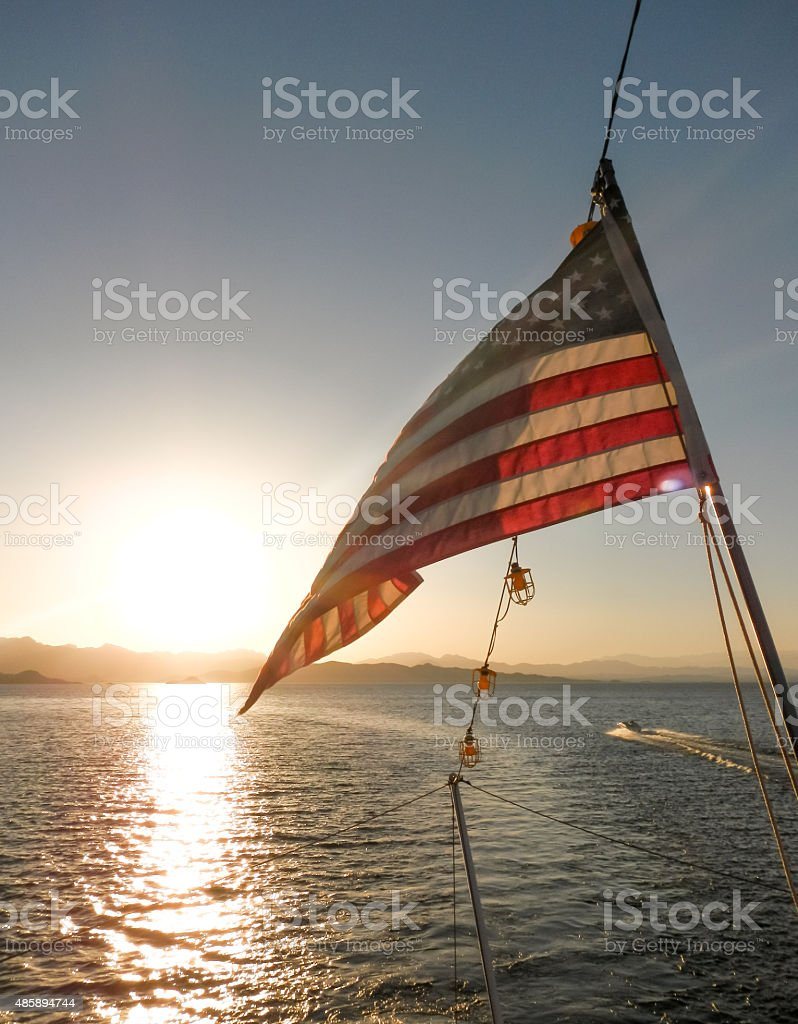 American Flag with Boat stock photo
