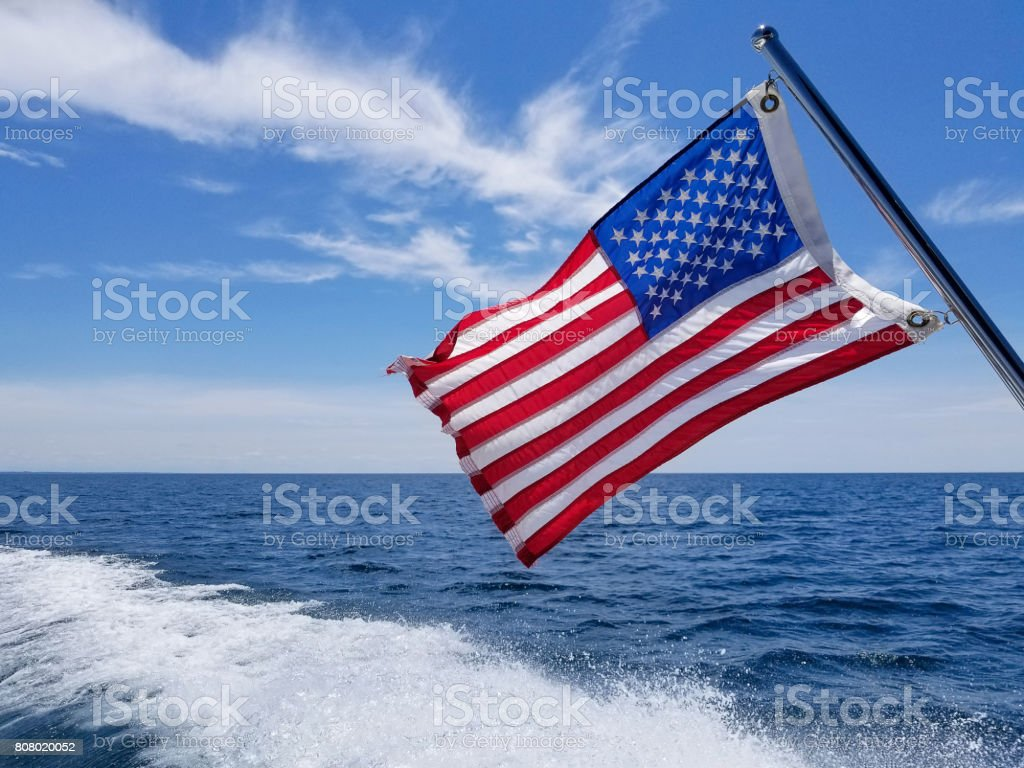 American flag with boat wake stock photo
