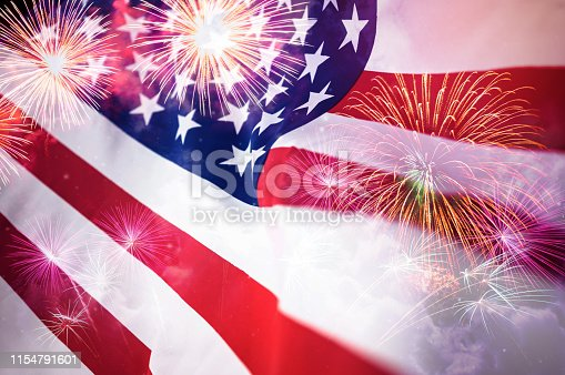 istock American flag with fireworks background 1154791601