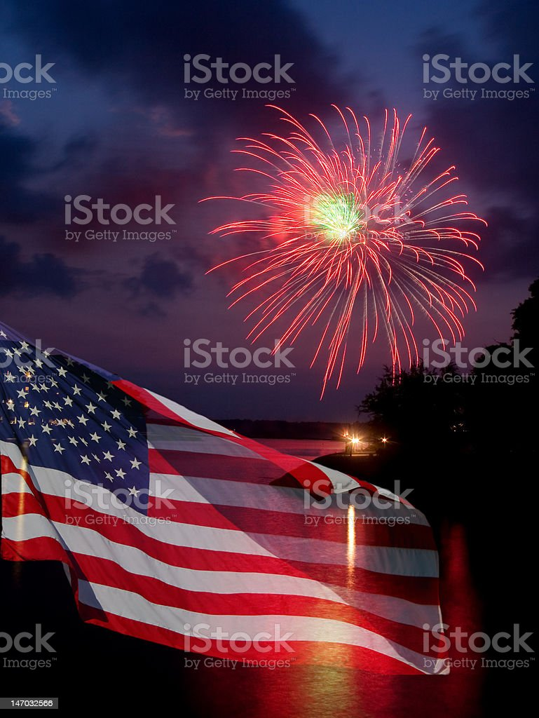 American flag with fireworks in background royalty-free stock photo