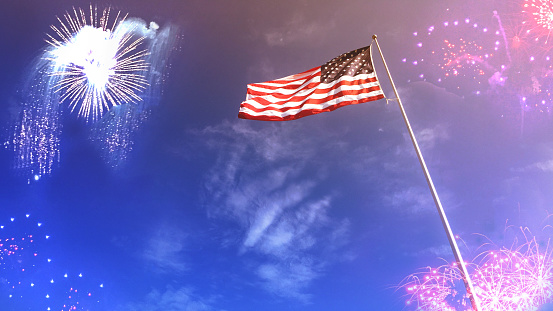 American Flag and Flagpole with Fireworks in Blue Sky