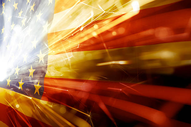 American flag with flared white light over the stars stock photo