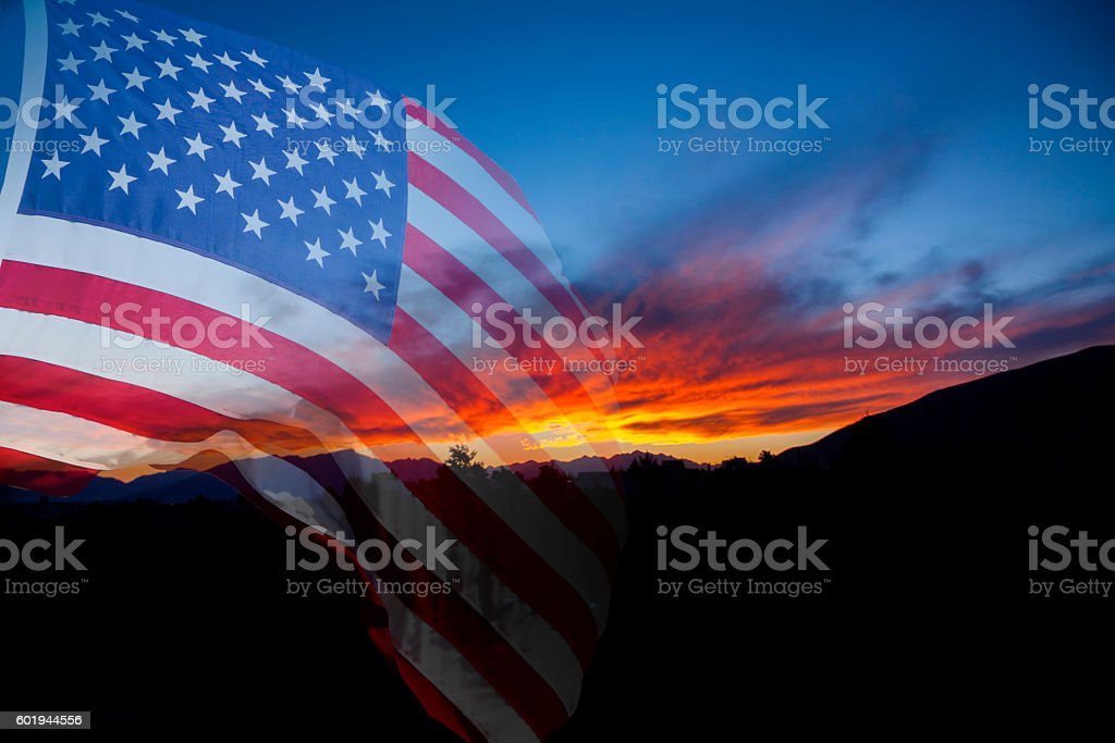 American flag with landscape sunset background. stock photo