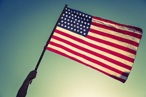 istock American flag with stars and stripes hold 485365782