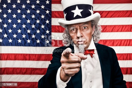 A stock photo of Uncle Sam pointing against a USA flag in the background with the iconic