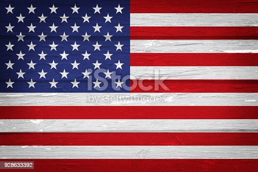 518726782 istock photo American flag with vintage look on wooden background 928633392