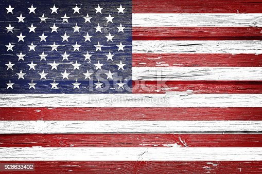 518726782 istock photo American flag with vintage look on wooden background 928633402
