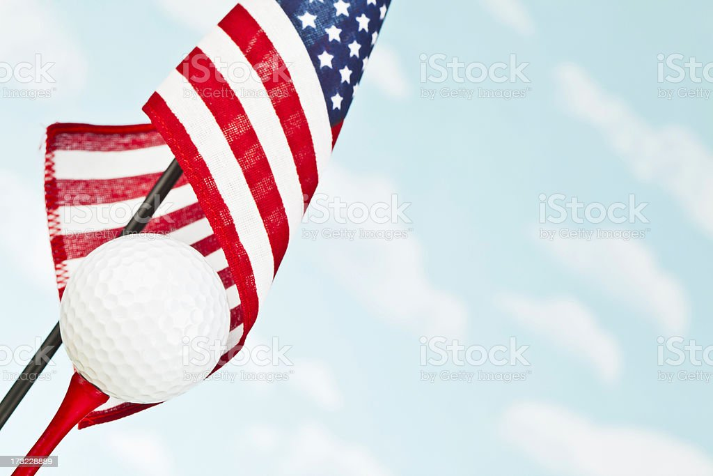 American Flag with White Golf Ball on Red Tee stock photo