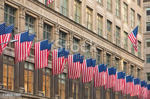 American Flags Against Office Building