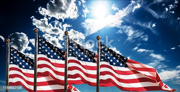 american flags against the sky
