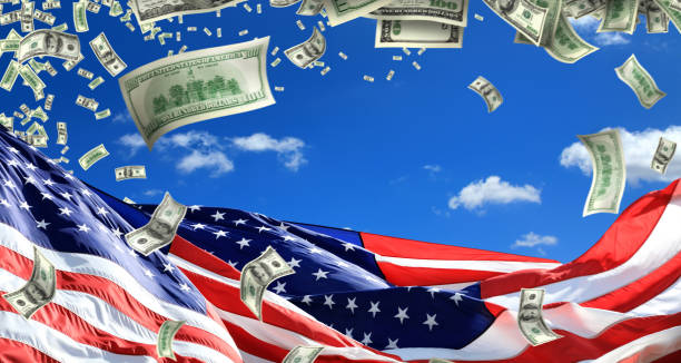 American flags and large group of falling money stock photo