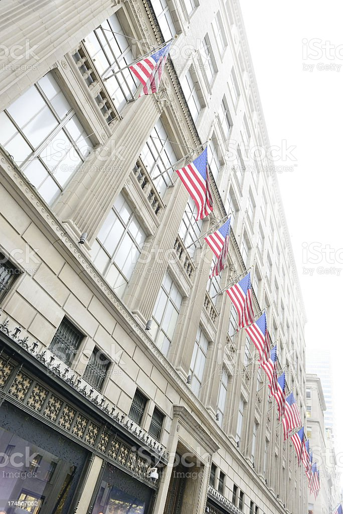 American flags and tall buildings in NYC royalty-free stock photo
