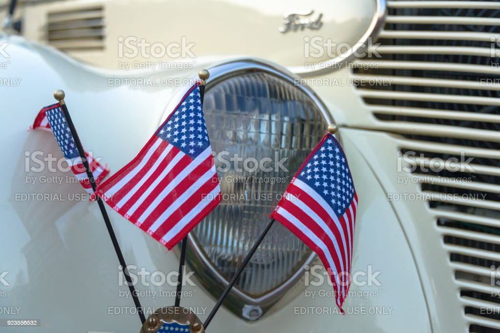American Flags And Vintage Ford Headlight Stock Photo