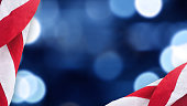 American Flags Border Over Defocused Blue Bokeh Lights Background