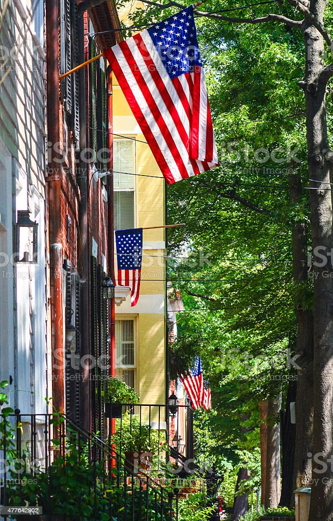 American flags flown in a neighborhood in the United States stock photo