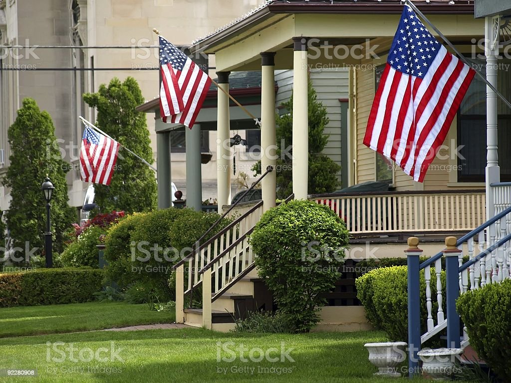 American flags flying from front porches stock photo