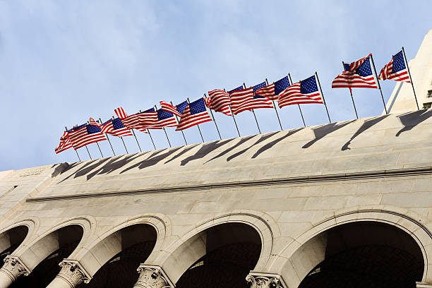 American Flags Flying over a building stock photo