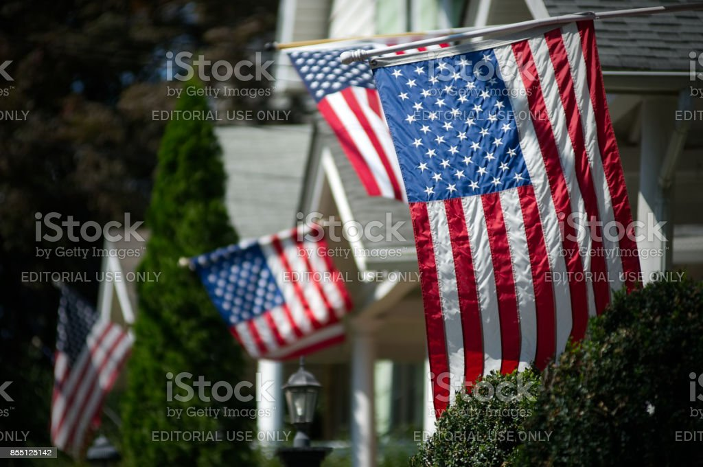 American Flags in UpperMmiddle Class Suburban Neighborhood stock photo