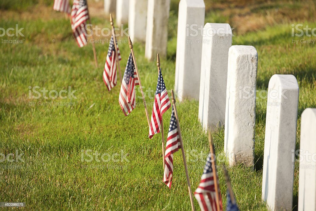 American flags near gravestones at Arlington National Cemetery in Virginia stock photo