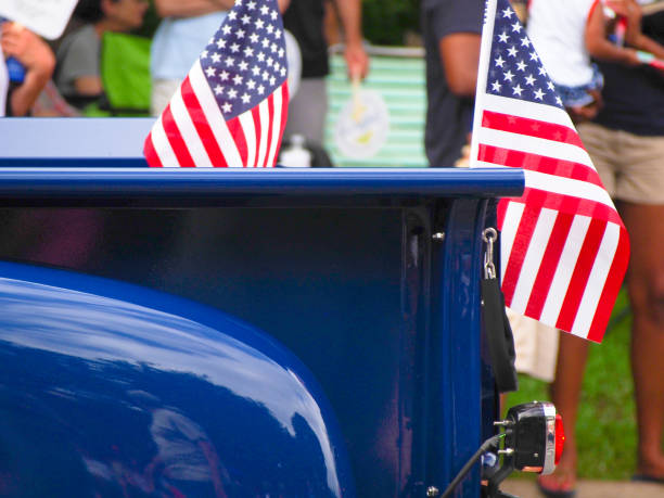 american flags on bright blue classic pickup truck in fourth of july parade - fourth of july стоковые фото и изображения