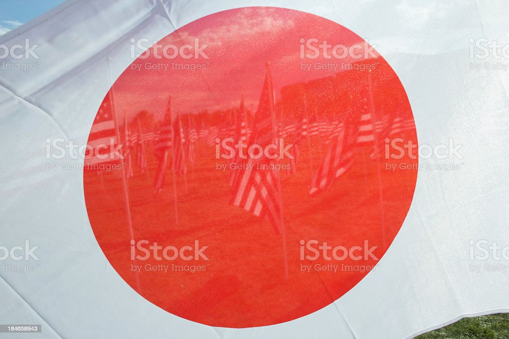 American Flags visible through red circle of Japanese flag royalty-free stock photo