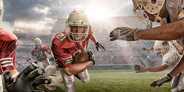 american football action - american football player stock photos and pictures