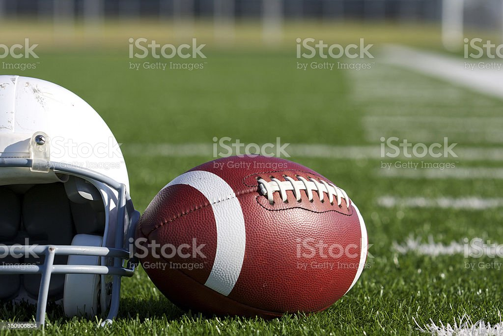 American Football and Helmet on the Field stock photo
