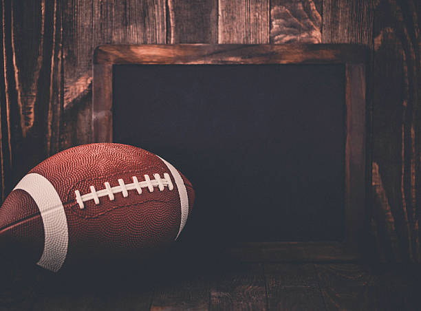 American football background with blank chalkboard for message stock photo